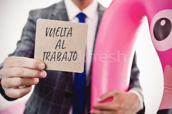 businessman and text back to work in spanish Stock photo © nito