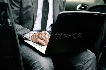 businessman using a laptop in a car Stock photo © nito