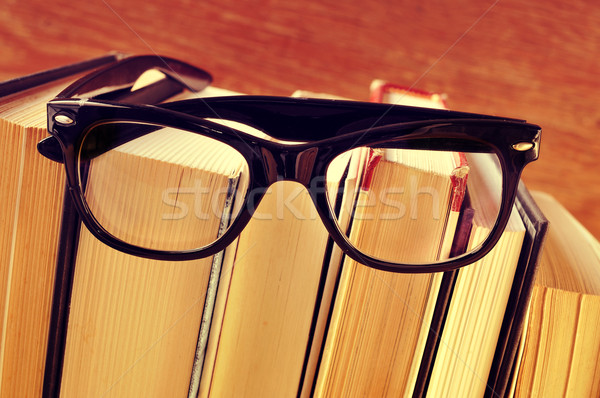 books and eyeglasses, with a retro effect Stock photo © nito