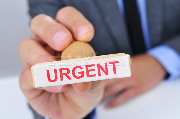 man with a rubber stamp with the word urgent Stock photo © nito