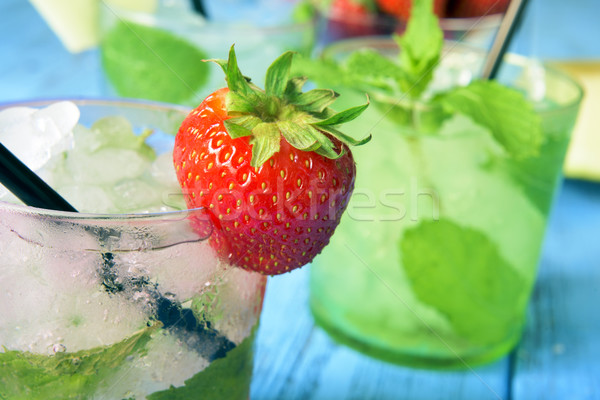 refreshing strawberry mojito on a rustic blue table Stock photo © nito
