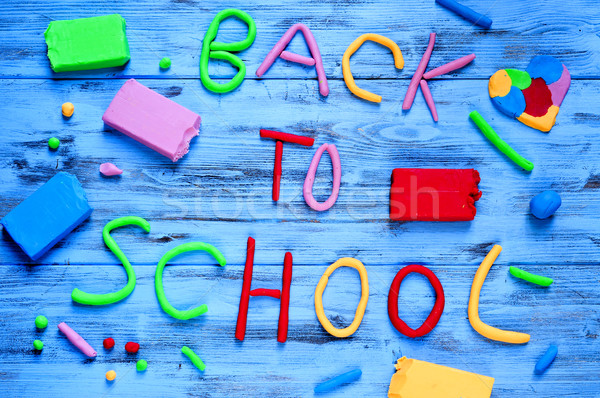 back to school written with modelling clay of different colors Stock photo © nito