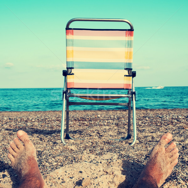 chair and young man on the beach, filtered Stock photo © nito