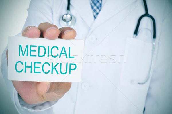 doctor showing a signboard with the text medical checkup Stock photo © nito