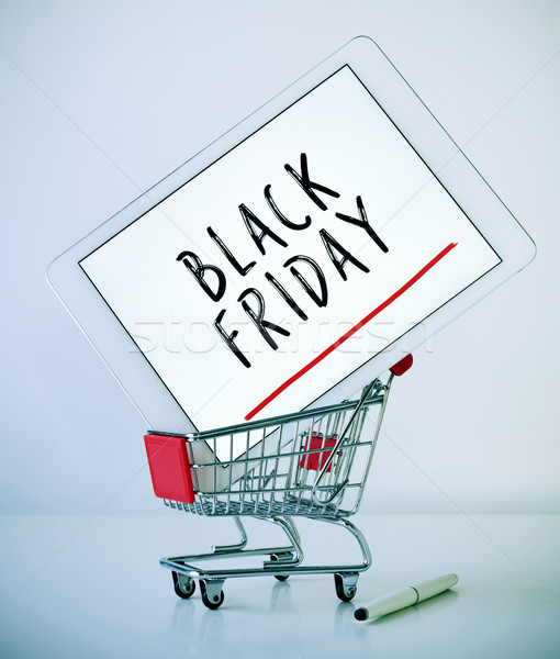 tablet with text black friday in a shopping cart Stock photo © nito