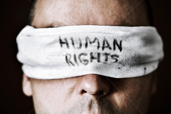 young man with a blindfold with the text human rights Stock photo © nito