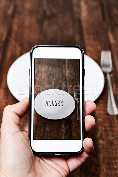 taking a picture of a plate with the word hungry Stock photo © nito