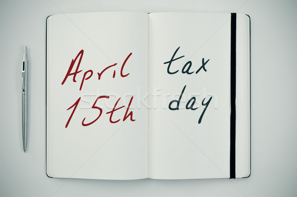 text april 15th tax day in a notepad Stock photo © nito