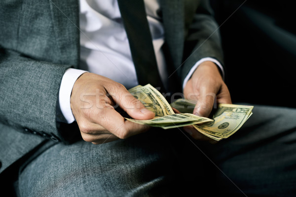 man counting dollar bills in the back of a car Stock photo © nito