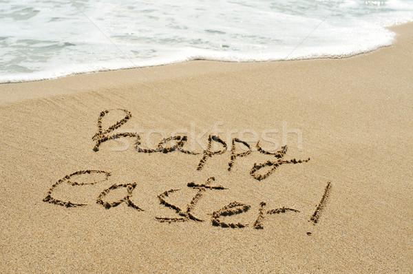Iyi paskalyalar yazılı kum plaj ıslak köpüklü Stok fotoğraf © nito