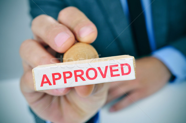 man with a rubber stamp with the word approved Stock photo © nito