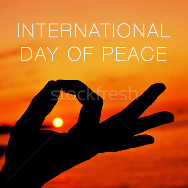 hands in gyan mudra and text international day of peace Stock photo © nito