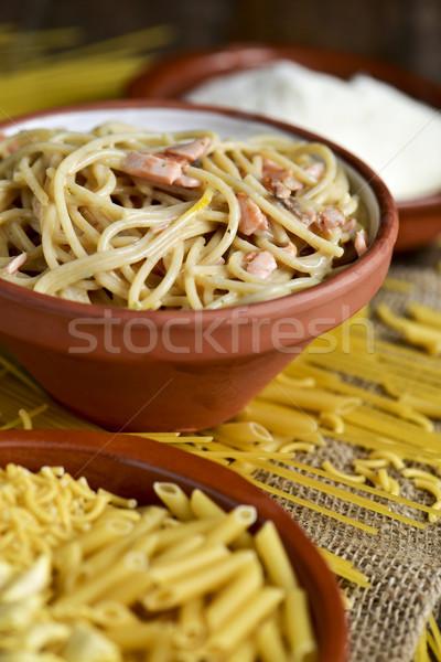 uncooked pasta, spaghetti alla carbonara and grated cheese Stock photo © nito