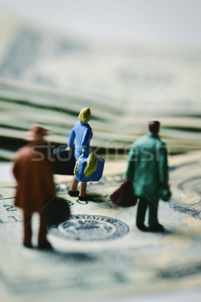 miniature travelers on dollar banknotes Stock photo © nito