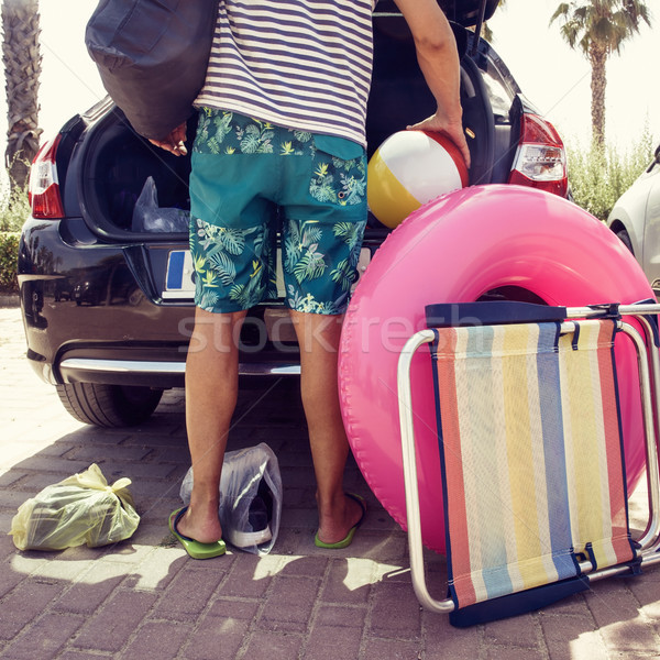 man putting beach stuff in the car Stock photo © nito