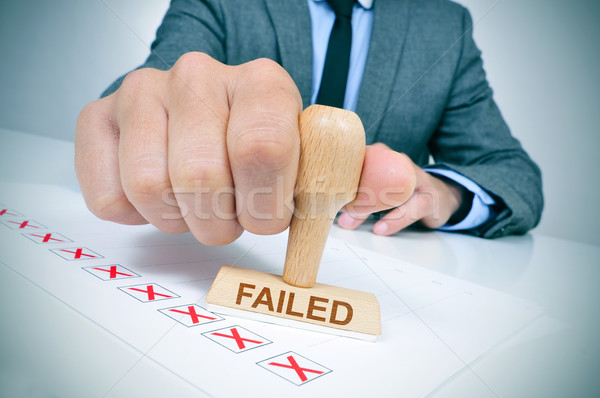 man with a rubber stamp with the word failed Stock photo © nito