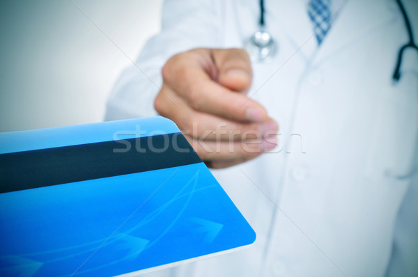doctor accepting a credit card Stock photo © nito