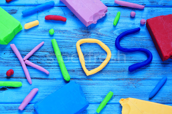 modelling clay of different colors forming the word kids Stock photo © nito