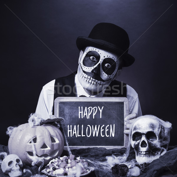 disguised man with chalkboard with text happy halloween, b&w Stock photo © nito