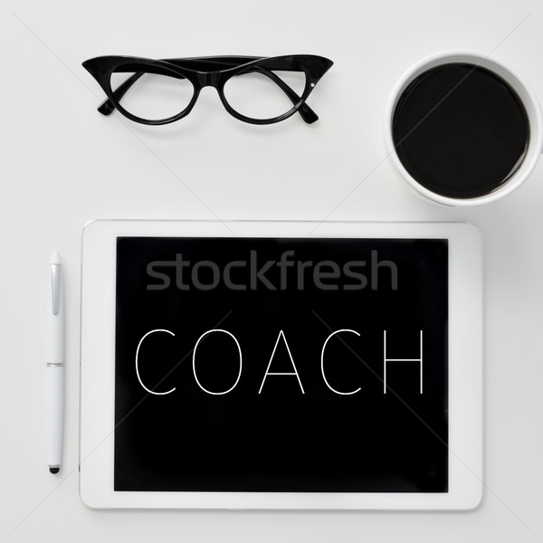 word coach on the screen of a tablet computer Stock photo © nito