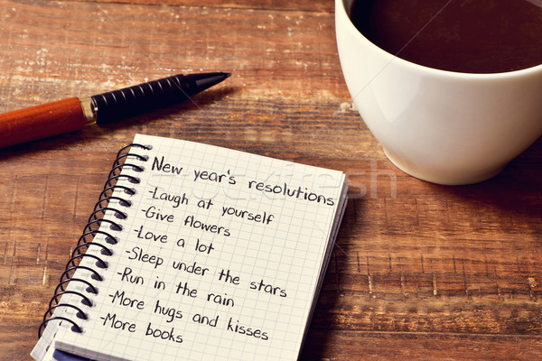 coffee and notepad with a list of new years resolutions Stock photo © nito