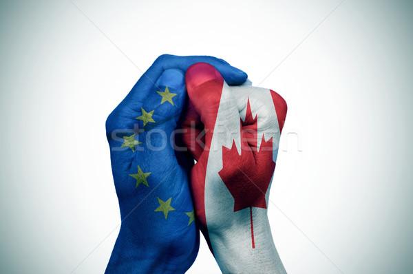Eller avrupa Kanada bayraklar el bayrak Stok fotoğraf © nito
