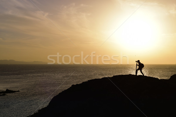 man taking a picture at dusk Stock photo © nito
