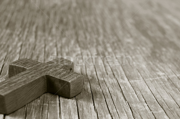 wooden Christian cross on a rustic wooden surface, sepia toning Stock photo © nito