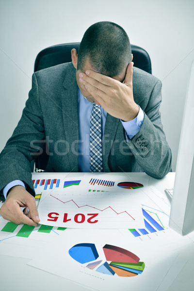 businessman observing a chart with a downward trend during 2015 Stock photo © nito