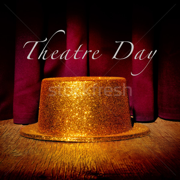 golden top hat on a stage and text theatre day Stock photo © nito