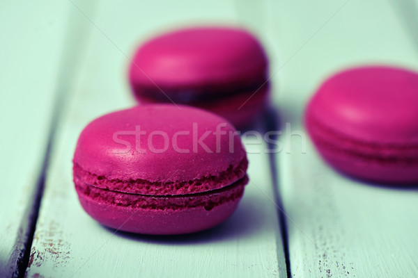 purple macarons on a pale blue rustic surface Stock photo © nito