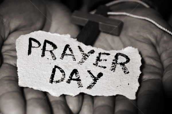 Stock photo: man with crucifix and text prayer day