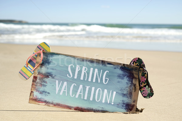 text spring vacation in a signboard on the beach Stock photo © nito