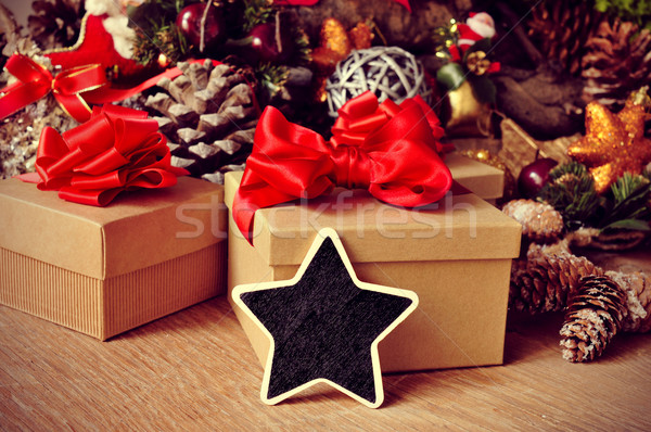 christmas gifts and blank star-shaped chalkboard Stock photo © nito