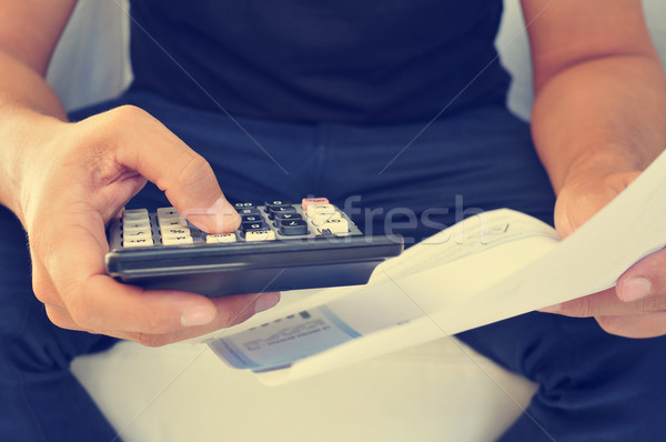 young man checking a bill, a budget or a payroll, filtered Stock photo © nito