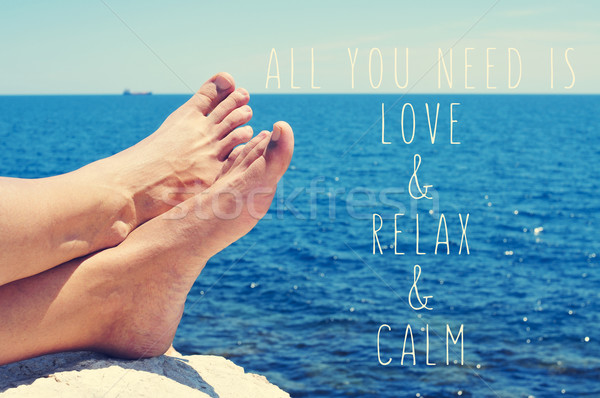 young man relaxing on the sea and text all you need is love and  Stock photo © nito