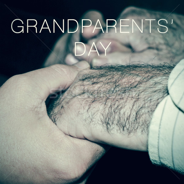 young man holding the hands of an old man and the text grandpare Stock photo © nito