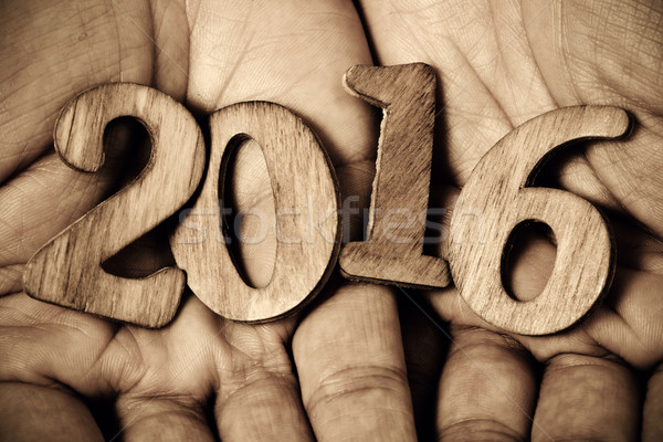 number 2016, as the new year, in the hands of a man Stock photo © nito