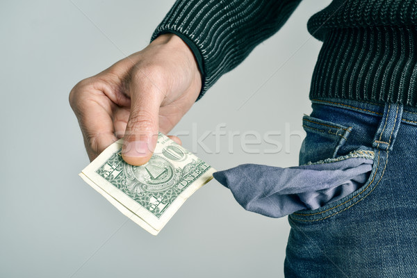 man with only one US dollar in his pocket Stock photo © nito