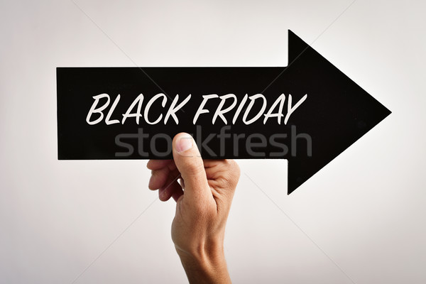 text black friday in an arrow-shaped signboard Stock photo © nito