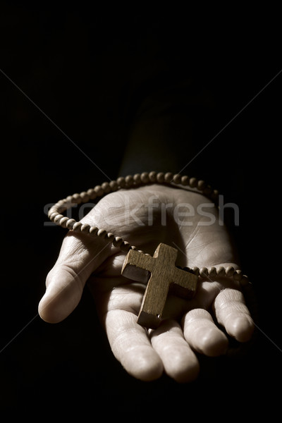 young man with a rosary in his hand Stock photo © nito