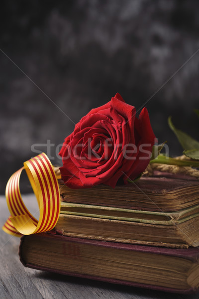 red rose, catalan flag and old books Stock photo © nito