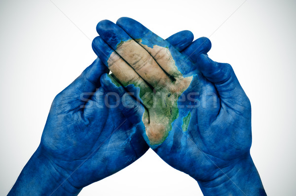 man hands patterned with a map of Africa (furnished by NASA) Stock photo © nito