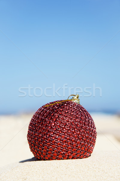 red christmas ball in the sand of a beach Stock photo © nito