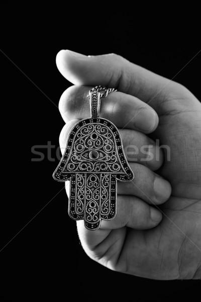Vieux amulette main jeune homme Photo stock © nito
