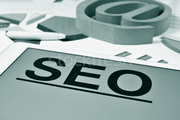SEO, for Search Engine Optimization, in the screen of a tablet Stock photo © nito