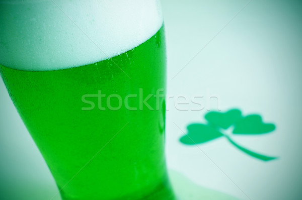 glass with dyed green beer and three-leaved shamrock, for saint  Stock photo © nito
