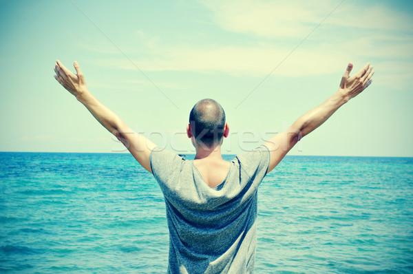 man with his arms in the air, with a slight vignette added Stock photo © nito