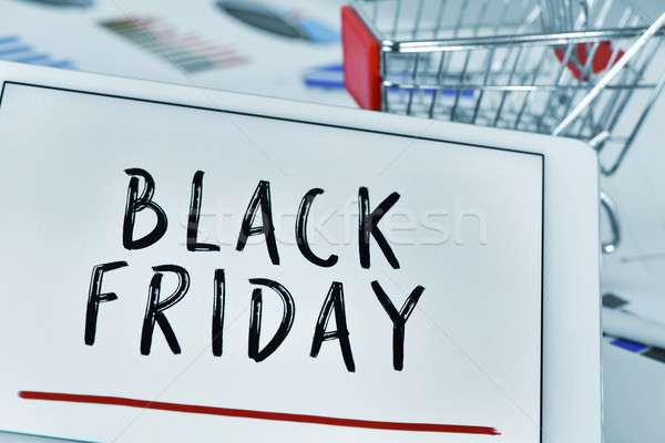 text black friday in a tablet and a shopping cart Stock photo © nito