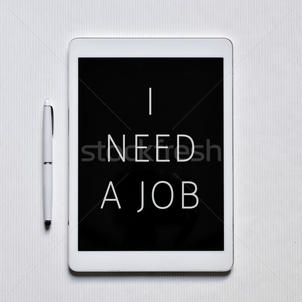 text I need a job in a tablet Stock photo © nito
